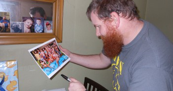 Spencer Clawson inspects his autograph on the BB15 cast photo he signed for me.
