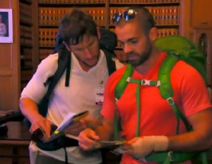 Rob Goddard and Ryan Steele look through thousands of book on the Finale of The Amazing Race Canada 2