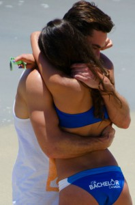 Tim Warmels and April Brockman connect on the beach infront of all the other girls on The Bachelor Canada episode 3
