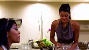 Claudia Jordan breaks a glass trying to get the ladies  attention on RHOA Drama Detox