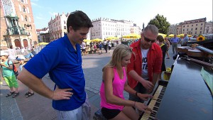 """Krakow, I'm Gonna Get You""--In Detour B, Joey (left) and Kelsey (center) must earn 100 Zloty, the Polish currency, by performing a piece of music on a piano in Krakow's Old Town Square in order to receive the next clue on THE AMAZING RACE, Friday, Nov. 13 (8:00-9:00 PM, ET/PT) on the CBS Television Network. Photo: CBS ©2015 CBS Broadcasting, Inc. All Rights Reserved"